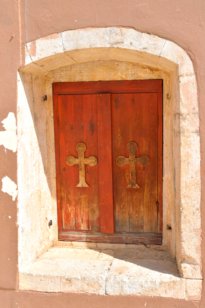 mediterranea: Window of old church in Hersonissos on Crete island, Greece.