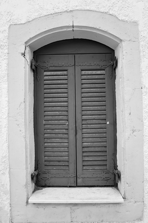 mediterranea: Window of an old building in Hersonissos, Crete, Greece. Black and white.