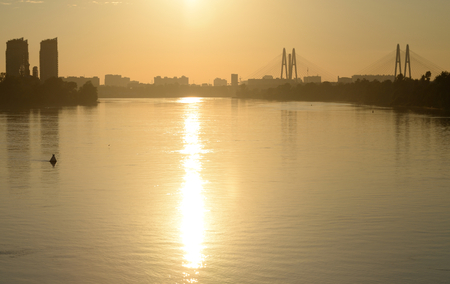outskirts: Cable stayed bridge and Neva river on the outskirts of St. Petersburg at sunset, Russia.
