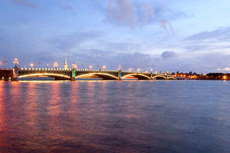 Trinity bridge and Neva River at night in St.Petersburg, Russia. Stock Photo
