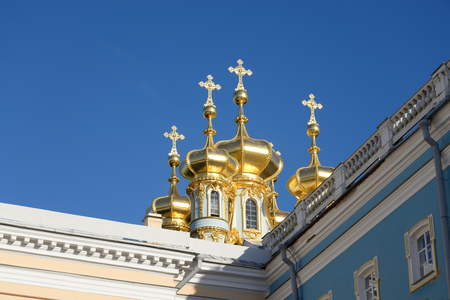 rococo: Golden cupolas of Catherine Palace church on the sky background, suburb of St.Petersburg, Russia. Stock Photo