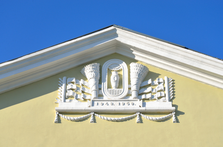 stalin empire style: Bas-relief on building in the style of Stalin in Metallostroy, outskirts of St. Petersburg, Russia.