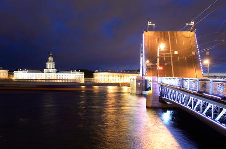 Palace Bridge, Neva River and University Embankment at night in St.Petersburg, Russia.