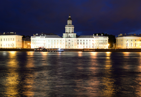 View of University Embankment and Cabinet of curiosities at night in St.Petersburg, Russia.