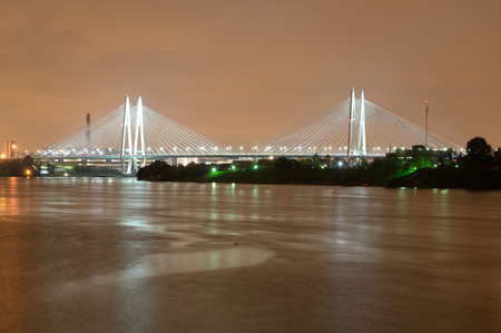 Cable-stayed bridge with illumination across the Neva River in St.Petersburg, Russia.
