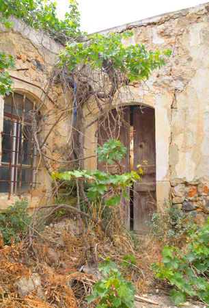 Old destroyed house in the historic part of Hersonissos, Crete, Greece.