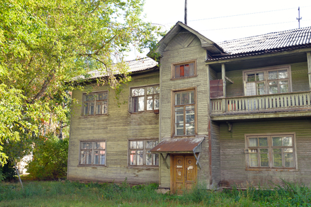dilapidation: VOLOGDA, RUSSIA - 11 AUGUST 2016: Old wooden building in the central part of Vologda. The citys population - 312,686 people. It is one of the largest cities in north-west Russia.