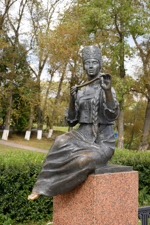 VOLOGDA, RUSSIA - 11 AUGUST 2016: Muse in the image of the Vologda peasant girl with a pipe. Fragment of monument to the poet Konstantin Batyushkov was opened in 1987 on the banks of the Vologda River. Editorial