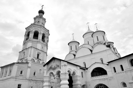 spassky: Spassky Cathedral with bell tower in Saviour Priluki Monastery by cloud day near Vologda, Russia. Black and white. Editorial