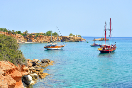 HERSONISSOS, GREECE - 30 MAY 2016: Several pleasure boats in the sea near the coast of Crete island. Crete - the biggest Greek island, the fifth largest island in the Mediterranean Sea. Editorial