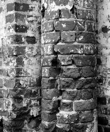 disrepair: Close up red brick wall texture grunge background. Black and white.