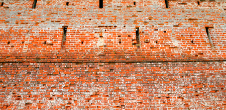 Close up red brick wall texture grunge background.