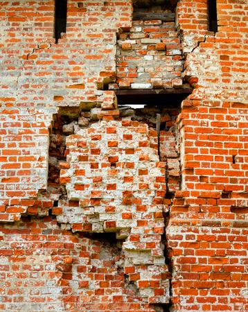 disrepair: Close up red brick wall texture grunge background.