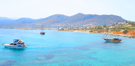 Pleasure boats in the sea near the coast of Crete island, Greece.