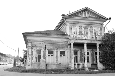 decrepitude: VOLOGDA, RUSSIA - 11 AUGUST 2016: Old wooden building in the central part of Vologda. The citys population - 312,686 people. It is one of the largest cities in north-west Russia. Black and white. Editorial