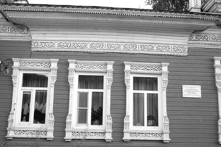 VOLOGDA, RUSSIA - 11 AUGUST 2016: Old wooden building in the central part of Vologda. The citys population - 312,686 people. It is one of the largest cities in north-west Russia. Black and white. Editorial