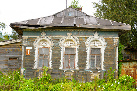 VOLOGDA, RUSSIA - 12 AUGUST 2016: Old wooden building in Village Priluki on the outskirts of Vologda. The citys population - 312,686 people. It is one of the largest cities in north-west Russia.