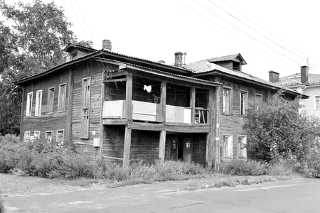decrepitude: VOLOGDA, RUSSIA - 12 AUGUST 2016: Old wooden building in the central part of Vologda. The citys population - 312,686 people. It is one of the largest cities in north-west Russia. Black and white.