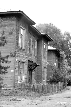 VOLOGDA, RUSSIA - 12 AUGUST 2016: Old wooden building in the central part of Vologda. The citys population - 312,686 people. It is one of the largest cities in north-west Russia. Black and white.