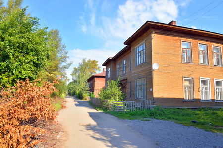 Street with old wooden building in the central part of Vologda, Russia. Stock Photo