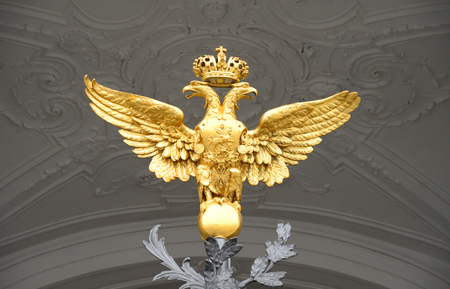double headed: Double-headed eagle - the emblem of the Russian Empire at the gate of the State Hermitage in St.Petersburg, Russia.