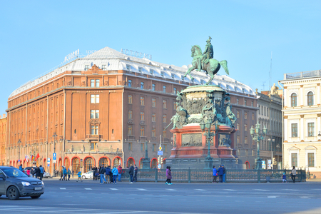 nikolay: ST.PETERSBURG, RUSSIA - 27 MARCH 2016: The monument to Nicholas I and Hotel Astoria at sunny spring day in St.Petersburg, Russia.