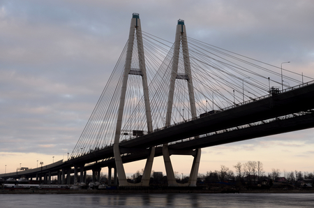 Silhouette of cable stayed bridge at evening on outskirts of St.Petersburg, Russia. Stock Photo