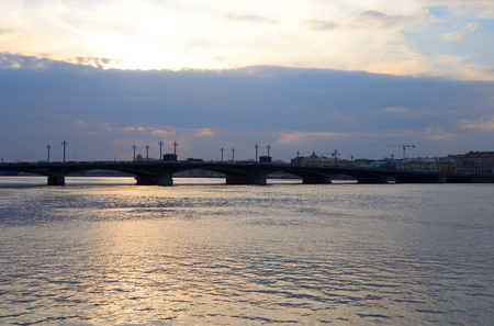 Silhouette of Annunciation bridge and Neva River at sunset, St.Petersburg, Russia.