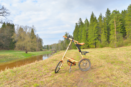 ST.PETERSBURG, RUSSSIA - 30 APRIL 2016: Bicycle Strida in Pavlovsk park. Strida - folding bike with a memorable frame in the shape of the letter A.