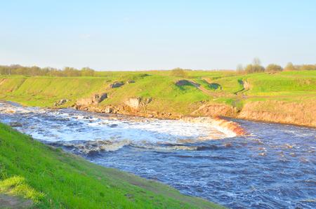 leningrad: Small waterfall on Tosna River in Leningrad Region, Russia. Stock Photo