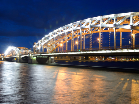 Peter the Great Bridge at night in St.Petersburg, Russia.