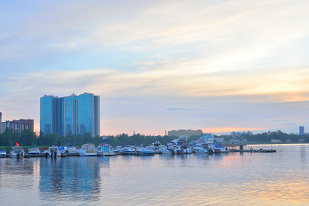 leningrad: ST.PETERSBURG, RUSSIA - 19 JUNE 2016: View of the boat pier on Neva river on the outskirts of St. Petersburg at sunset, Russia.