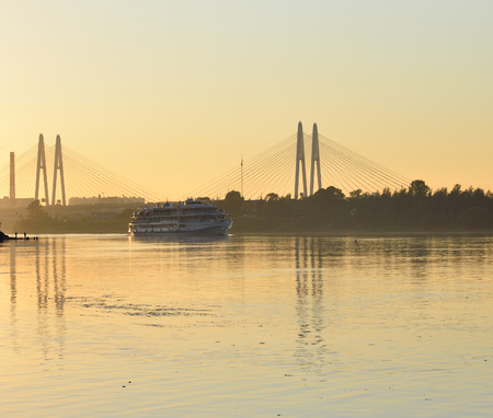 leningrad: Cable stayed bridge and Neva river on the outskirts of St. Petersburg at sunset, Russia.