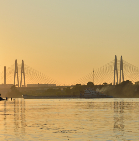 Cable stayed bridge and Neva river on the outskirts of St. Petersburg at sunset, Russia.