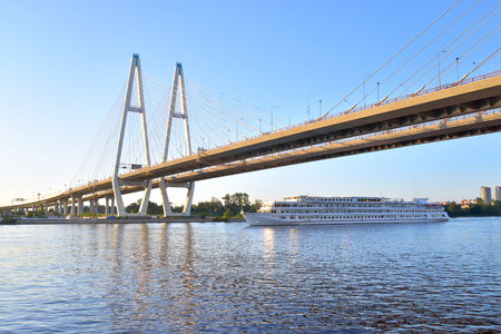 ST.PETERSBURG, RUSSIA - 14 JULY 2016: Cable stayed bridge, Neva river and cruise ship on the outskirts of St. Petersburg, Russia.