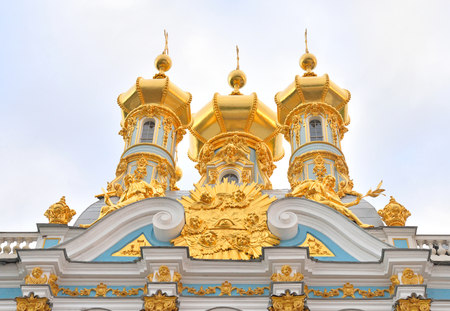 Golden cupolas of Catherine Palace church at cloud day, suburb of St.Petersburg, Russia.