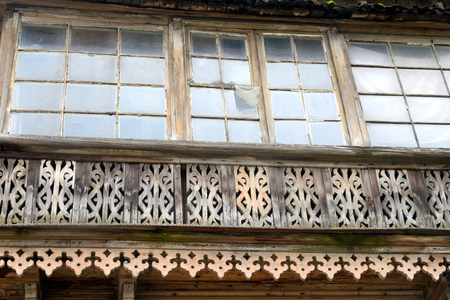 decrepitude: Window of old residential wooden building in Gatchina, Russia.