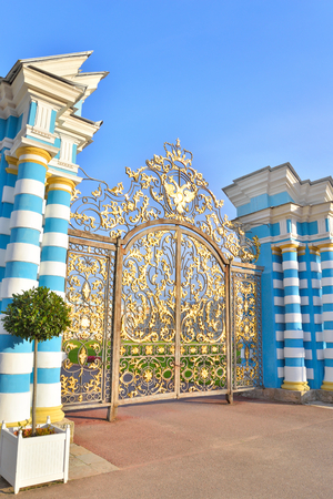 Gate of Catherine palace fence in Tsarskoye Selo with golden double-headed eagle, suburb of St.Petersburg, Russia.