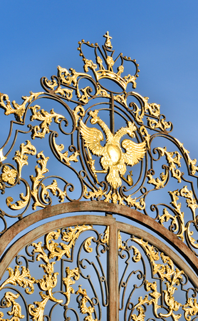 double headed: Fragment of Catherine palace fence in Tsarskoye Selo with golden double-headed eagle, suburb of St.Petersburg, Russia.