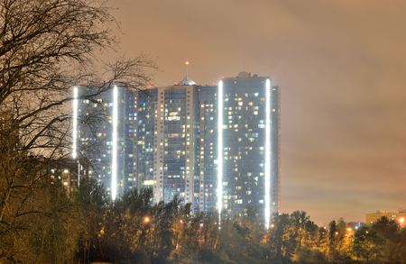 Contemporary residential skyscraper at night on the outskirts of St. Petersburg, Russia.