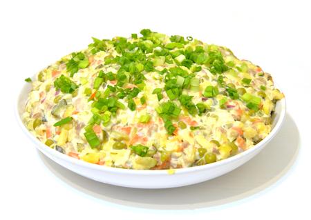 ensaladilla rusa: Traditional Russian salad with green onions close up.