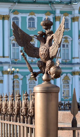 Double-headed eagle - the emblem of the Russian Empire on the fence of Alexander Column in St.Petersburg, Russia. Stock Photo