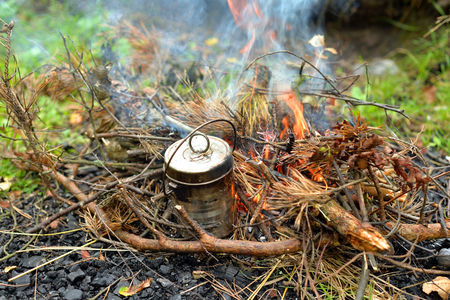 Bonfire on which is brewed pot at summer.