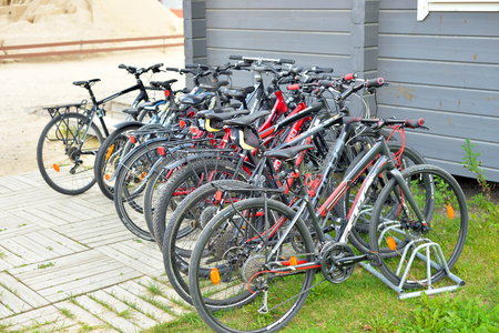 LAPPEENRANTA, FINLAND - AUGUST 18, 2017: Parked bicycles on city street. Lappeenranta - administrative, economic and cultural center of the province of South Karelia.