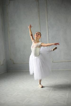 ST.PETERSBURG, RUSSIA - 27 MARCH 2017: Young woman dances a solo ballet in studio. Project Dancing Petersburg.