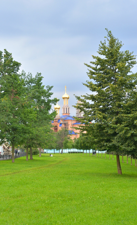 leningrad: Park in Rybatskoe and The Church of the Nativity of the Blessed Virgin Mary at summer in St.Petersburg, Russia. Stock Photo