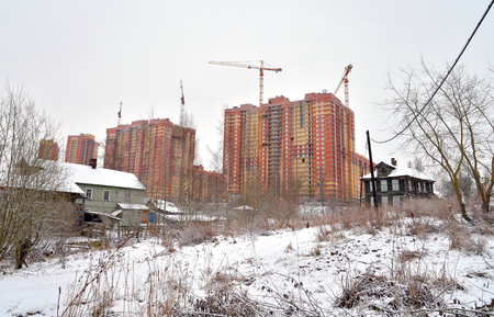 snowscene: Houses under construction on the outskirts of St. Petersburg, microdistrict Ribatskoe, Russia.