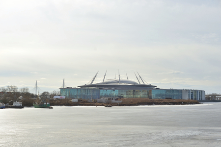 ST.PETERSBURG, RUSSIA - 21 MARCH 2017: The new Zenit Stadium and frozen Neva River.. Football stadium in the Krestovsky Island which is currently under construction. Editorial