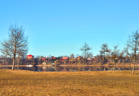 Park on coast of riverr at spring day. 写真素材