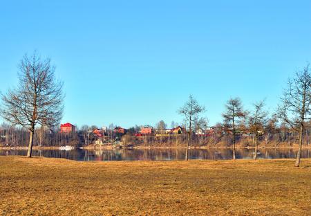 Park on coast of riverr at spring day. Reklamní fotografie